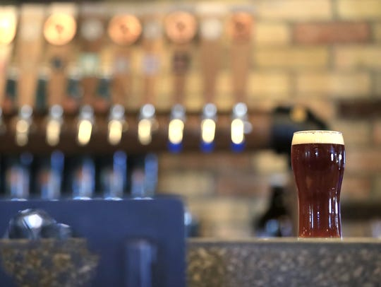 A beer sits on the bar at Copper State Brewery, 313