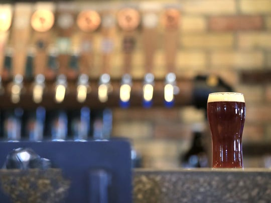 A beer sits on the bar at Copper State Brewery, 313 Dousman St., in Green Bay.