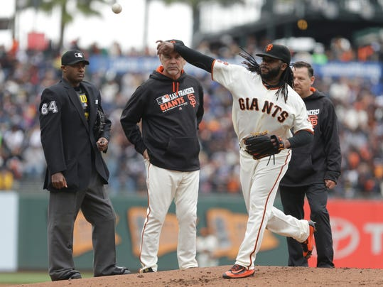 FILE - In this April 10, 2016, file photo, San Francisco Giants pitcher Johnny Cueto is examined by home plate umpire Alan Porter, left, and manager Bruce Bochy in the first inning of a baseball game against the Los Angeles Dodgers in San Francisco. Major League Baseball's average game time slowed during the first week of the season and was back over 3 hours. There were slight changes in the pace rules this year, cutting the timer for between-inning breaks by 20 seconds and adding a 30-second timer for visits to the mound by managers and pitching coaches. (AP Photo/Ben Margot, File)