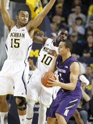 Northwestern's Reggie Hearn plays against Michigan
