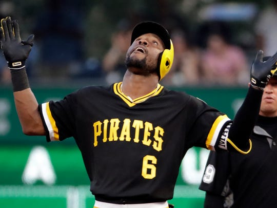 Pittsburgh Pirates' Starling Marte stands on second after driving in a run with an RBI double off Philadelphia Phillies starting pitcher Zach Eflin during the third inning of a baseball game in Pittsburgh, Saturday, July 20, 2019. (AP Photo/Gene J. Puskar)