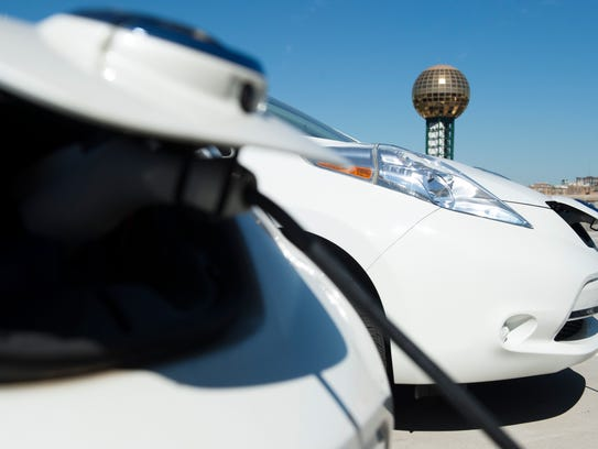 Electric vehicles charge on the roof of the 11th Street