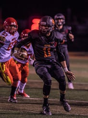 Aztec quarterback Cody Smith pivots to the right and