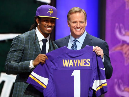 In this April 30, 2015, file photo, Trae Waynes greets NFL commissioner Roger Goodell after being selected as the number eleven overall pick to the Minnesota Vikings in the first round of the 2015 NFL Draft at the Auditorium Theatre of Roosevelt University. (Jerry Lai-USA TODAY Sports)