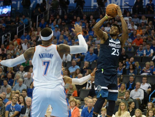 Minnesota Timberwolves forward Jimmy Butler (23) shoots