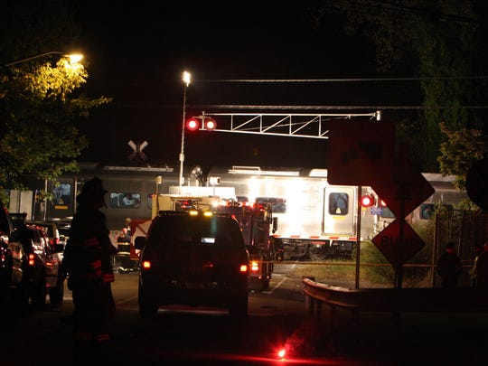 Bedford Hills firefighters and MTA police work at the scene of a collision between a train and a car at the Green Lane crossing in Bedford Hills Sept. 29, 2008.  A GPS unit may have caused the incident, instructing the driver to turn onto the tracks.