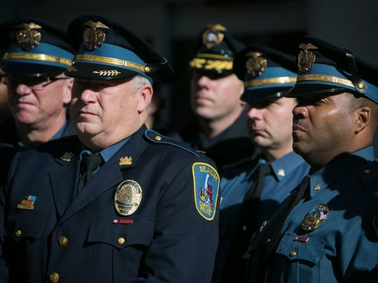 Members of the Capital Police stand nearby as acting U.S. Attorney David Weiss answers questions outside of the Federal Courthouse after Amy Gonzalez and David Matusiewicz were sentenced to life in prison.