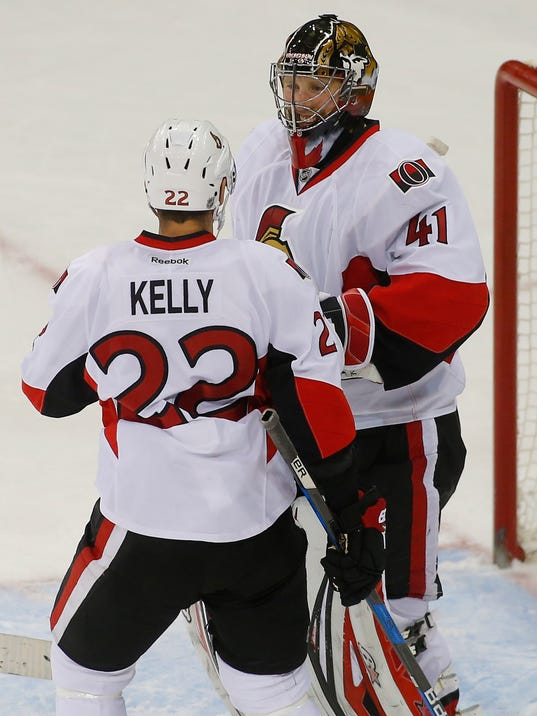 Ottawa Senators' goaltender Craig Anderson (41) is congratulated by teammate Chris Kelly (22) after recording a shutout against the New York Rangers at an NHL hockey game in New York, Sunday, Nov. 27, 2016. (AP Photo/Rich Schultz)
