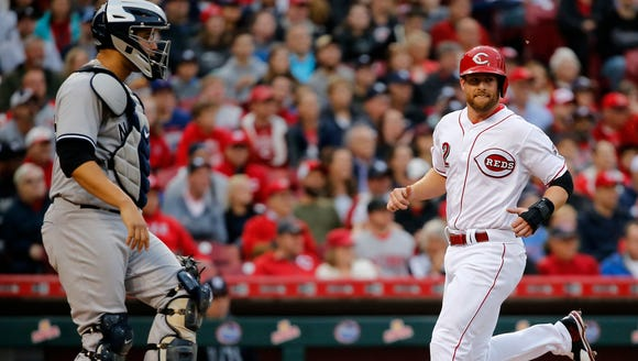 Cincinnati Reds shortstop Zack Cozart (2) scores a