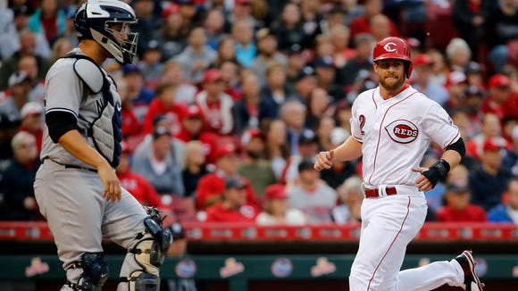 Cincinnati Reds shortstop Zack Cozart (2) scores a run in the second inning during the interleague baseball game between the New York Yankees and the Cincinnati Reds, Tuesday, May 9, 2017, at Great American Ball Park in Cincinnati.