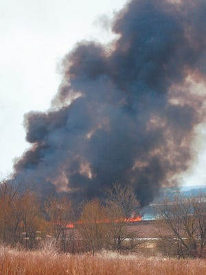 Smoke billows from a controlled burn conducted by the U.S. Fish and Wildlife Service in the Horicon National Wildlife Refuge in this file photo.