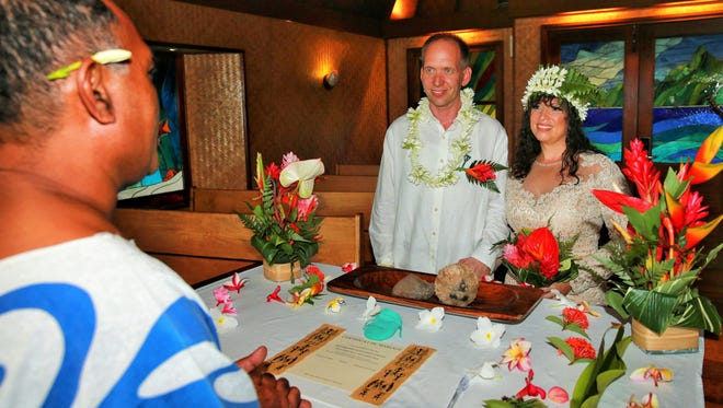 This priest presided over the Polynesian-style wedding of Greg and Lucie Dils of Tiffin last May on Bora Bora. The couple then spent the next eight months visiting relatives and friends throughout the U.S. to enjoy mini post-wedding receptions.