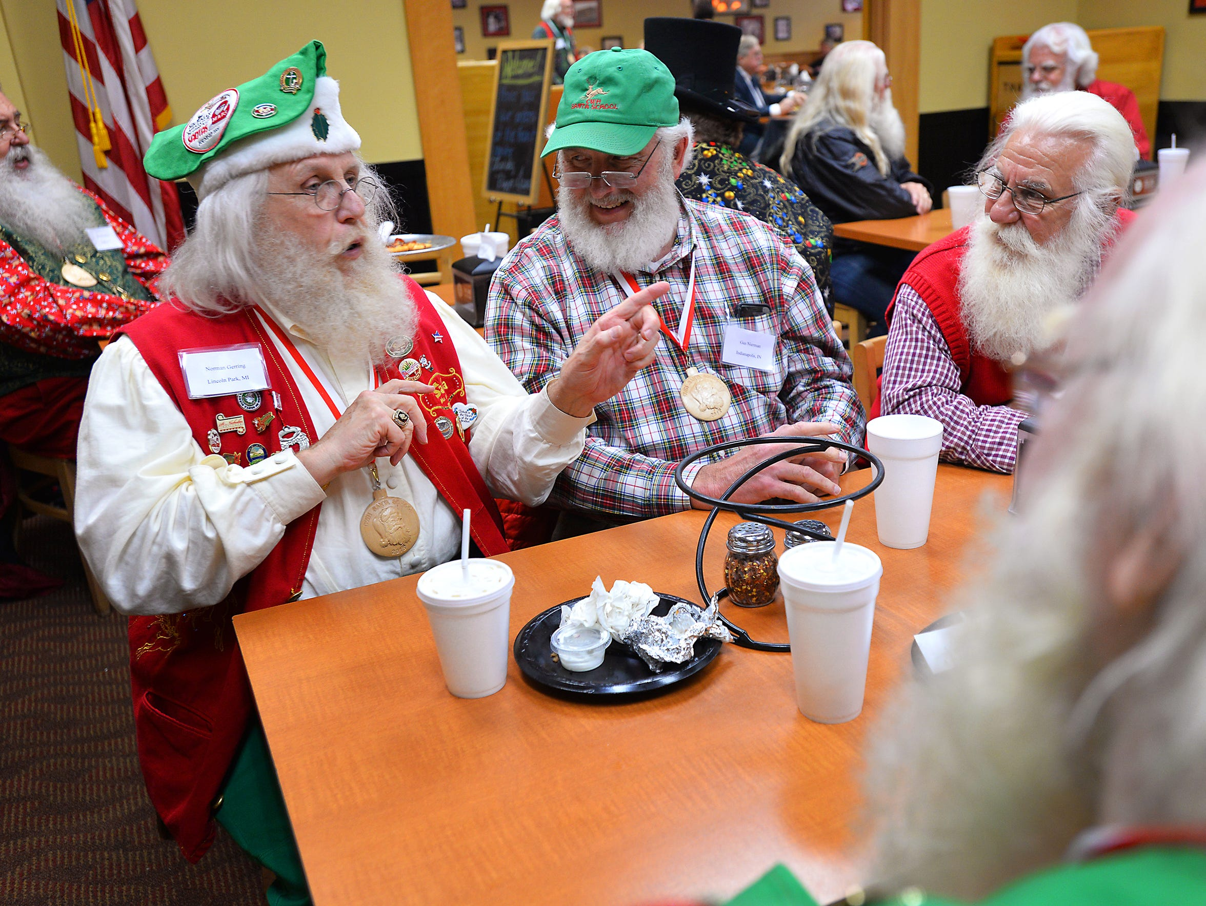 Longtime Santas including Norm Gerring of Lincoln Park,