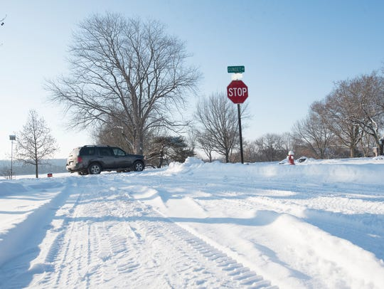 Cars carefully drive down Sunset Drive in Chillicothe,