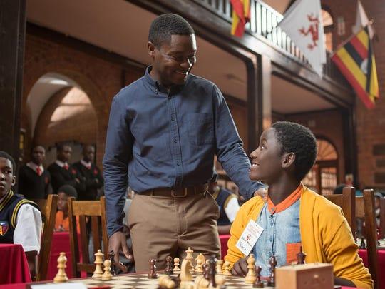 David Oyelowo (left) and Madina Nalwanga in a scene