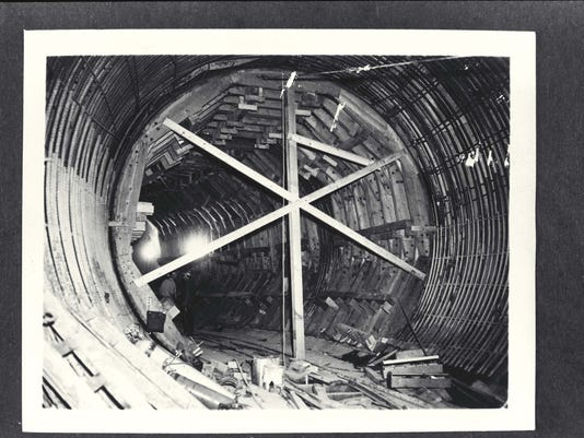 Tunnel interior showing process of construction with reinforcing  rods on sides and wooden ribs with cross in center. July 12, 1961. Shasta Historical Society 1982.63.32.
