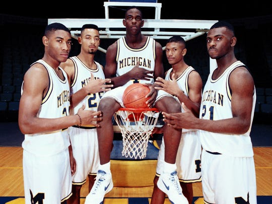 FILE - In this November 1991, file photo, Michigan's Fab Five from left, Jimmy King, Juwan Howard, Chris Webber, Jalen Rose and Ray Jackson pose in Ann Arbor, Mich.  (AP Photo/file)