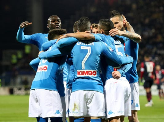 Napoli's Jose Callejon celebrates with teammates after scoring during the Italian Serie A soccer match between Cagliari and Napoli at the Sardegna Arena stadium in Cagliari, Monday, Feb. 26, 2018. (Fabio Murru/ANSA via AP)