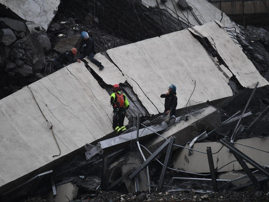 Rescues work among the debris of the collapsed Morandi