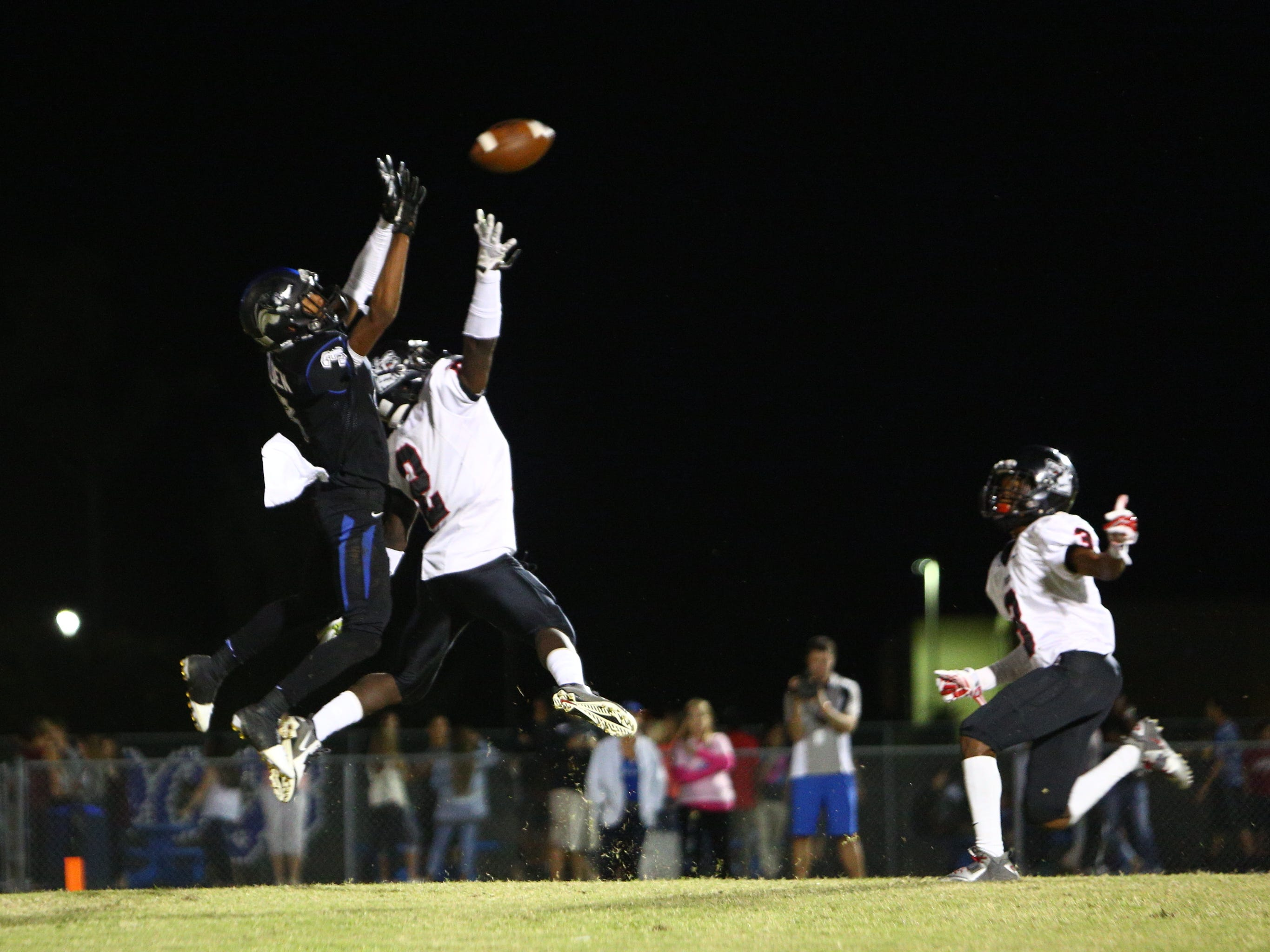 Ida Baker's Rasheed Golden goes up and catches a touchdown pass over South Fort Myers' Antwan Dixon in the second quarter of their game Friday night.