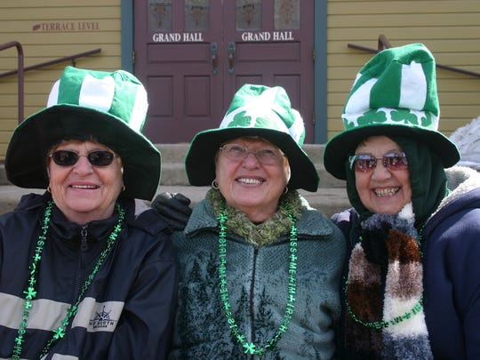 Nancy Grubb, Bobbi Scott and Carmen Near of Grand Ledge, wearing their green, wait by the Grand Ledge Opera House for the St. Patrick's Day Parade to begin.