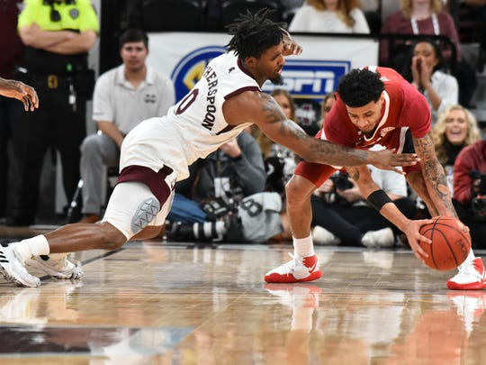 Feb 25, 2020; Starkville, Mississippi, USA; Mississippi State Bulldogs guard Nick Weatherspoon (0) battles for the ball with Alabama Crimson Tide guard James Bolden (11) during the first half at Humphrey Coliseum. Mandatory Credit: Matt Bush-USA TODAY Sports
