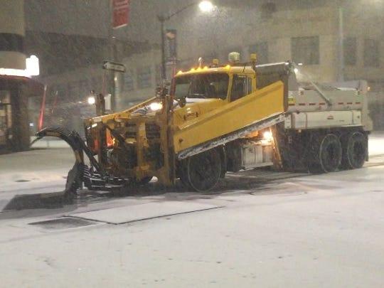 A snow plow in the City of Poughkeepsie works to clear the roads.