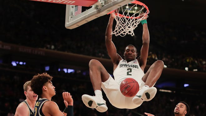 Michigan State forward Jaren Jackson Jr. (2) dunks the ball against Michigan during the first half of an NCAA Big Ten Conference tournament semifinal college basketball game, Saturday, March 3, 2018, in New York.