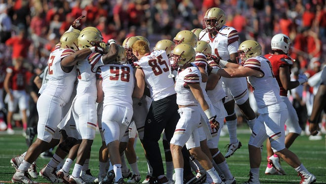 Boston College celebrates after beating Louisville 45-42 on Saturday at Papa John's Cardinal Stadium. Oct. 14, 2017