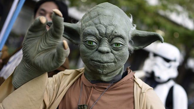 Fan dressed as Yoda at a Star Wars event in Tokyo