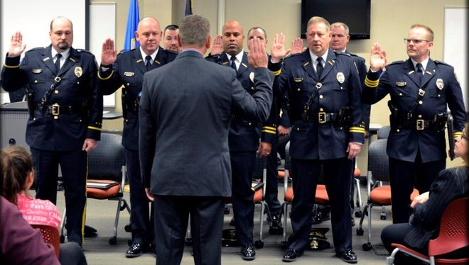 Mayor Dave Kleis swears in officers Monday who were promoted to new positions in the St. Cloud Police Department.