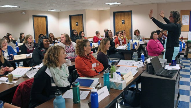 Emerge Wisconsin Executive Director Erin Forrest leads the group of about 50 women Saturday who are interested in learning what it would take to run for office as Democrats. Emerge said Saturday's class was double the normal size and attributed the interest to a response to the election of President Donald Trump.