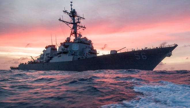 In this Jan. 22, 2017, photo provided by U.S. Navy, the USS John S. McCain conducts a patrol in the South China Sea while supporting security efforts in the region. The guided-missile destroyer collided with a merchant ship on Monday, Aug. 21, in waters east of Singapore and the Straits of Malacca. (James Vazquez/U.S. Navy via AP)