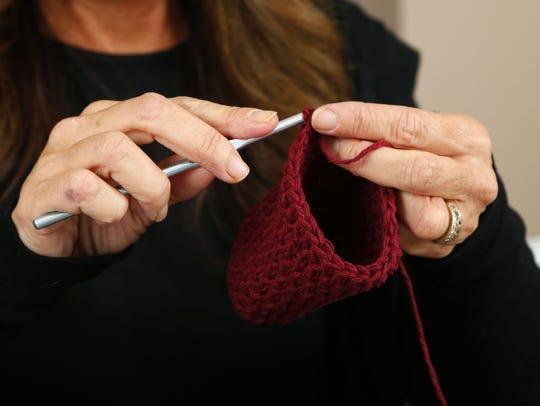 Stacy Wiener crochets a soap sack.