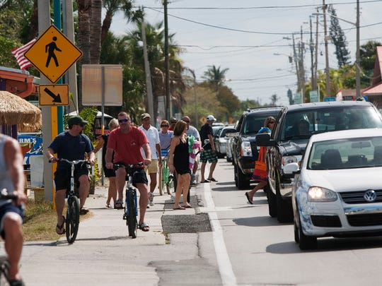 Estero Boulevard on Fort Myers Beach is packed with visitors, including spring breakers and seasonal residents.