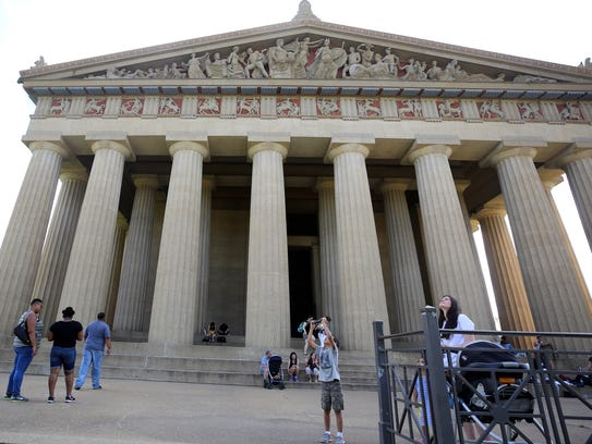 Visitors spend time outside the Parthenon on Aug. 27,
