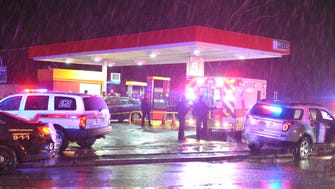 Police at the crime scene where man fatally shot at a gas station on Route 20 in Paterson on Monday.