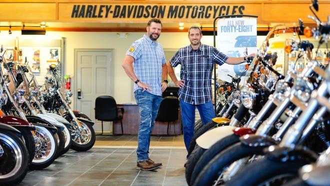 Brothers A.J. (left) and Geoffrey Hebert inside Cajun Harley Davidson in Scott.