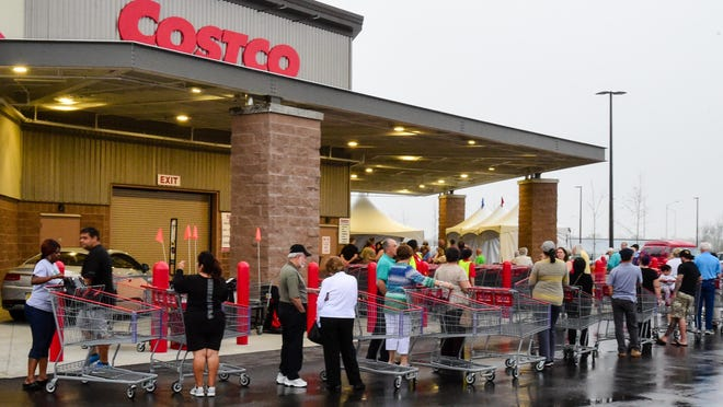 Customers begin arriving before 7 a.m. to wait in line for the doors to open. Customers began arriving before 7am to wait in line for the opening of the new Costco in the Ambassador Shopping Center. March 17, 2016.