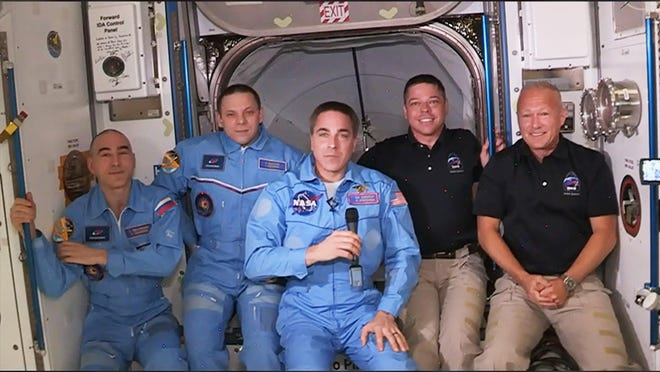 The International Space Station crew has expanded to five members with the arrival of the SpaceX Crew Dragon. From left, Anatoly Ivanishin, Ivan Vagner, Chris Cassidy, Bob Behnken and Doug Hurley.