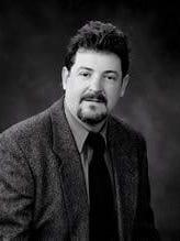 Commissioner Charlie Messer