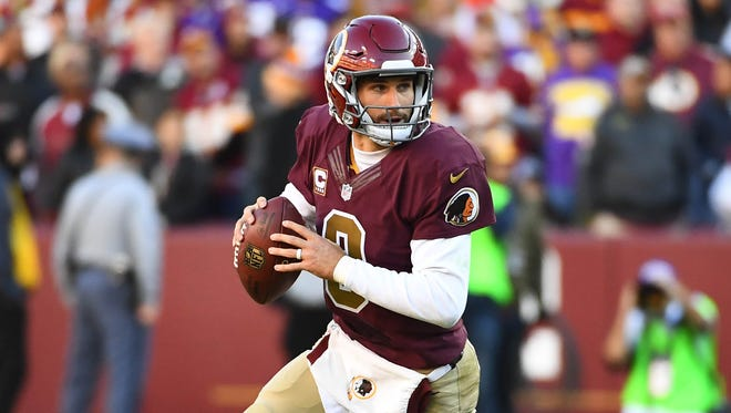Washington Redskins quarterback Kirk Cousins (8) rolls out against the Minnesota Vikings during the second half at FedEx Field.