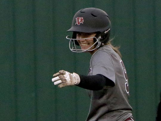 Vernon's Shay Williams points to her first base coach after hitting a double against  Iowa Park Tuesday, March 27, 2018, in Iowa Park.