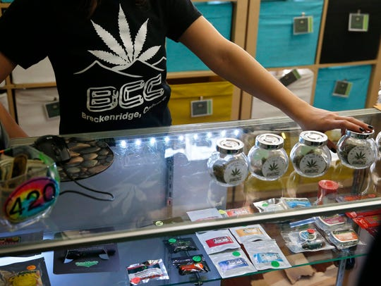 A pot store employee talks with customers  in Breckenridge,