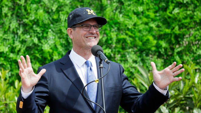 Michigan football coach Jim Harbaugh talks during a press conference in Rome on Wednesday, April 26, 2017 after going to the Vatican for a Papal address.