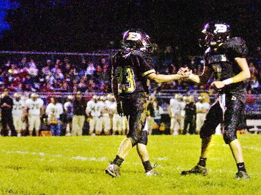 Biglerville's Oakley Fissel, left, and quarterback Tanner Cool celebrate a touchdown during their game against Delone Catholic last season.