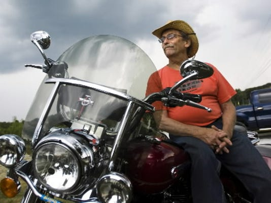 Bill Emig, of Gettysburg, rests on his Harley Davidson Road King at the Granite Hill Campground while event organizers and vendors were preparing for Bike Week in 2012.