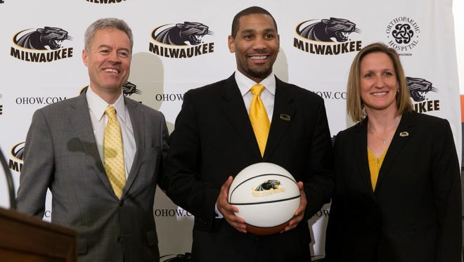 New UW-Milwaukee men's basketball coach Lavall Jordan (center) is shown with chancellor Mark Mone (left) and Amanda Braun during a news conference this spring.