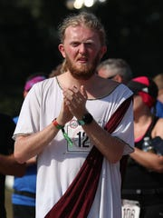 Lucas Biggerstaff dressed as Jesus prior to the Roo Run at the Bonnaroo Music and Arts Festival 2018 on early Saturday morning, June 9, 2018