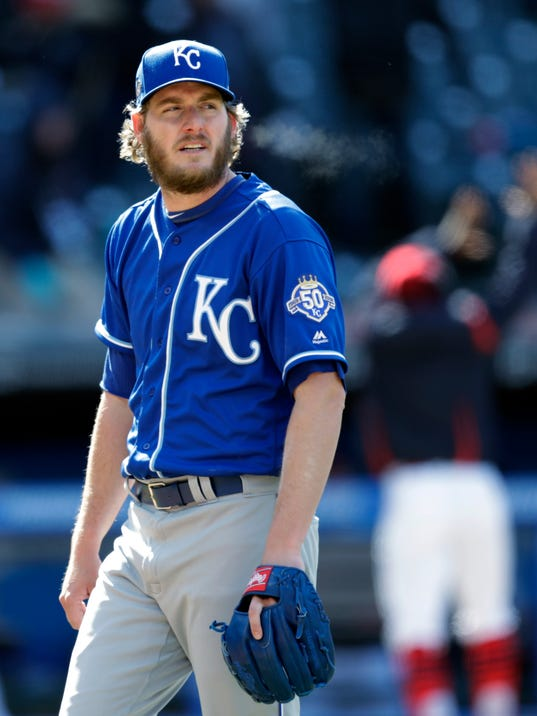Kansas City Royals relief pitcher Brandon Maurer walks off the field after giving up a two-run home run to Cleveland Indians' Yan Gomes in the ninth inning of a baseball game, Sunday, April 8, 2018, in Cleveland. Erik Gonzalez scored on the play. The Indians won 3-1. (AP Photo/Tony Dejak)